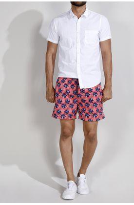 Pantaloneta-de-baño-estampado-palmeras-fondo-rojo